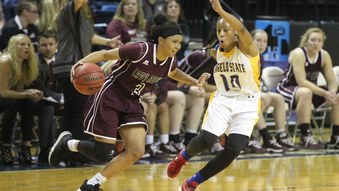 Angelo State's Marquita Daniels (right) scored 17 points in Saturday's 61-59 loss against No. 2 Lubbock Christian in the NCAA Division II South Central Regional semifinals at the Rip Griffin Center in Lubbock. It was her final game.