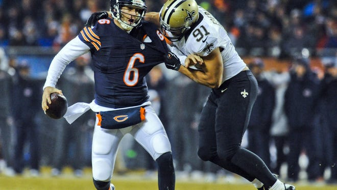 Chicago Bears quarterback Jay Cutler (6) is sacked by New Orleans Saints outside linebacker Kasim Edebali (91)  in the first half of their game at Soldier Field on Monday.
