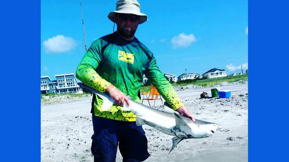 Eric H. with a nice brown shark that was released back into the waters off Brigantine.