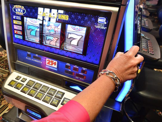 A customer plays a slot machine at the Casino at Ocean