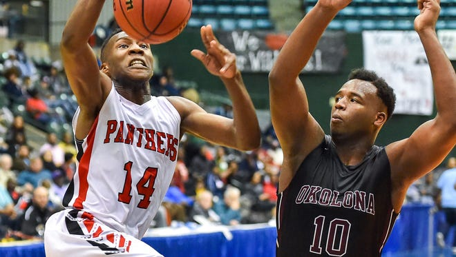 Coahoma County's Markevius Phillips (14) drives against Okolona's Ladarrius Spears (10)  during MHSAA 2A Boys Semifinal action held March 7th, 2017 at the Mississippi Coliseum in Jackson, MS. (Bob Smith-Special to the Clarion Ledger)