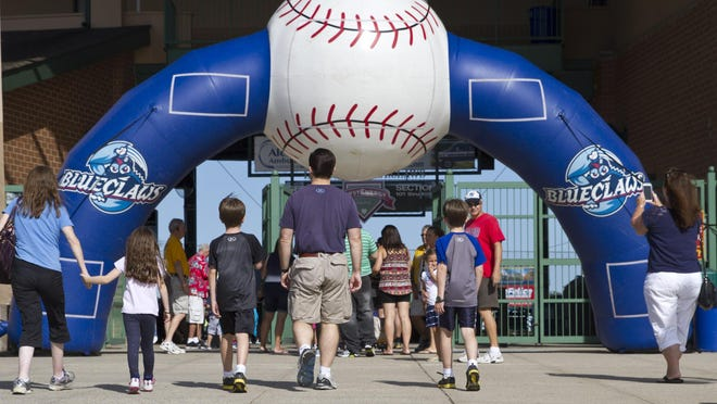 Fans enter FirstEnergy Park before a game last year.