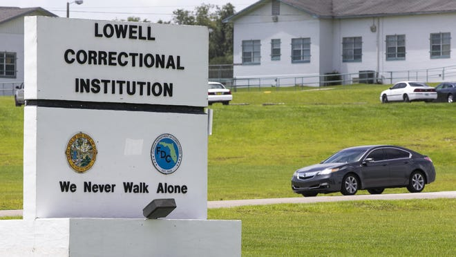 A vehicle exits the ground of the Lowell Correctional Institution on Thursday. The prison, as well as the nearby Florida Women's Reception Center, is in ZIP code 34482, where the number of positive tests for COVID-19 has increased from 551 on Monday to 1,360 on Thursday, according to the state Department of Health.