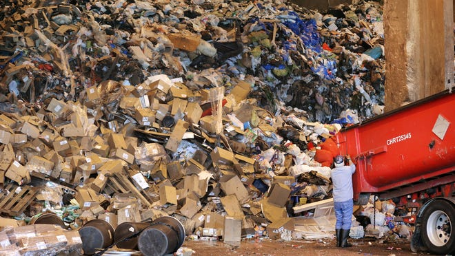 Trucks bring in materials to the tipping floor at Covanta, an energy from waste facility, on Tuesday, June 10, 2014. Covanta, located at 2320 S. Harding Street in Indianapolis, is building a new recycling plant next to the incinerator and plans to break ground in 2015.