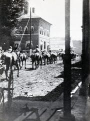 Construction crew of the O'Gee rides down Landry Street in Opelousas in 1907.