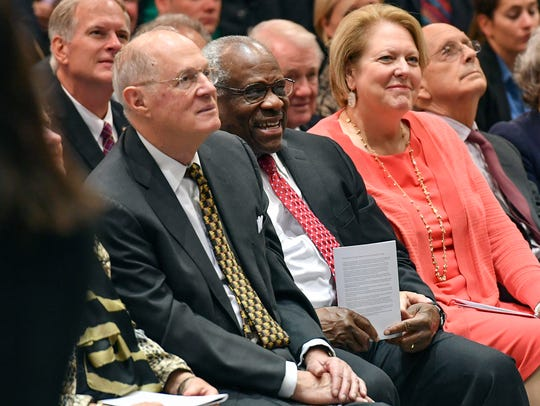 Justice Clarence Thomas breaks out in familiar laughter