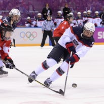 Team USA's Anne Schleper, right, vies with Canada's Jayna Hefford in the women's ice hockey gold medal game during the 2014 Winter Olympics in Sochi, Russia. Schleper, a 2008 St. Cloud Cathedral graduate, is playing in the World Championships in Malmo, Sweden, this week.