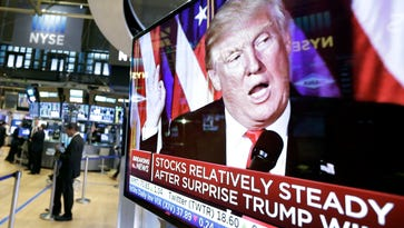 Trump Rally is born: An image of President-elect Donald Trump appears on a TV screen at the New York Stock Exchange on Nov. 9, 2016, the first trading day after his surprise Election Day win. (AP Photo/Richard Drew)