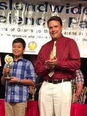 "Congratulations, to Brian Gerard Galang a seventh-grade student at Saint Anthony Catholic School for garnering third place in the 40th annual Science Fair - Physical Category ""Creepy Heat"" on May 5, 2018 at the University of Guam. Awarding was held on May 19, 2018 at the Guam Hilton Hotel. Pictured is Brian Galang and Joe Slomka , president of MEGAbyte a sponsor for the science fair."