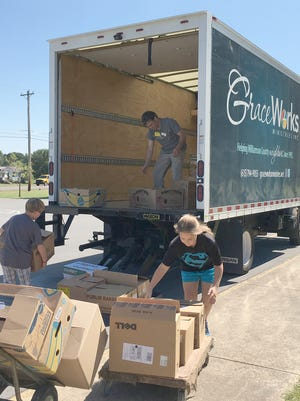Fairview Elementary School students help load 2,600 pounds of food collected in their recent food drive which will help stock the food pantry at GraceWorks West.