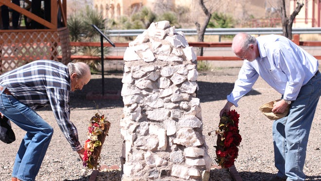Chuck Forgrave, left and Dr. R. Bouilly lay memorial wreaths at the base of the monument commemorating the loss of 17 Americans during Pancho Villa's raid on Columbus in 1916. The Columbus Historical society holds the annual event to pay tribute to the Americans lost during the raid.
