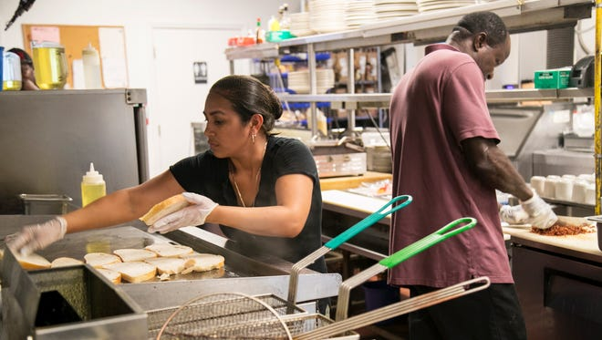 Isabel Romero and Toby Bonavit prep for Wednesday's lunch at Cristof's in Fort Myers. It was their first time serving since Hurricane Irma hit the area. The restaurant got its power back on Tuesday night.