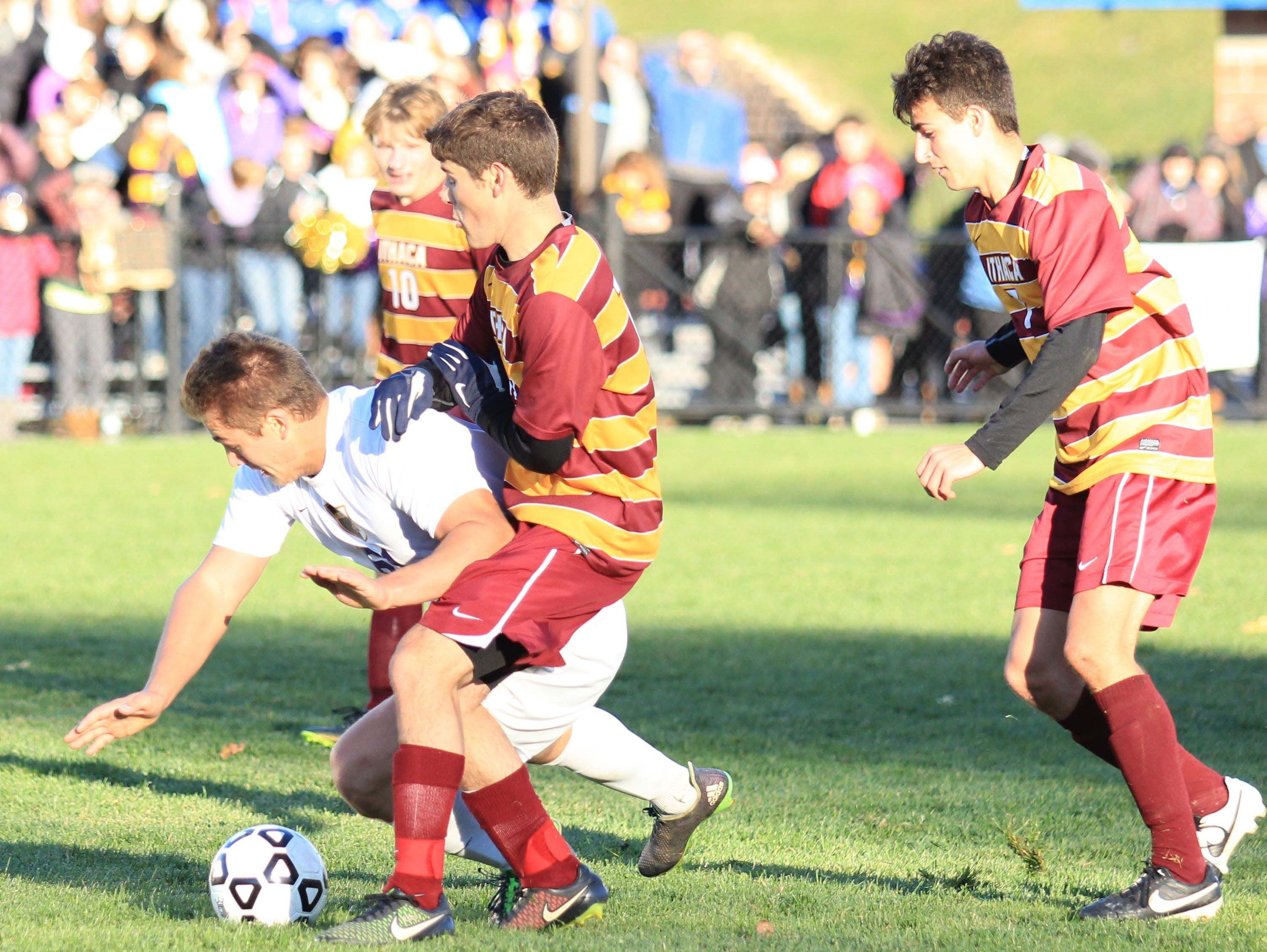 Ithaca players get physical to take the ball away during NYSPHSAA semi final in Middletown, NY