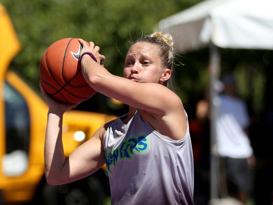 Tiffany Behary passes to her Monstars teammate during Hoopla outside the Oregon State Capitol in Salem on Saturday, Aug. 5, 2017.