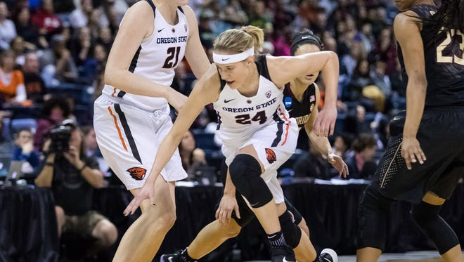 Oregon State Beavers guard Sydney Wiese (24) scrambles for a loose ball against the Florida State Seminoles in the first quarter in the semifinals of the Stockton Regional of the women's 2017 NCAA Tournament at Stockton Arena. Mandatory Credit: John Hefti-USA TODAY Sports