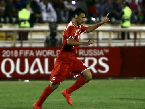 Abdulrazak al-Husein of Syria celebrates scoring his