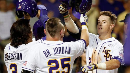 LSU's Greg Deichmann (7) celebrates his three-run home run with Kramer Robertson (3) and Bryce Jordan (25) during the fourth inning of an NCAA college baseball tournament Super Regional.