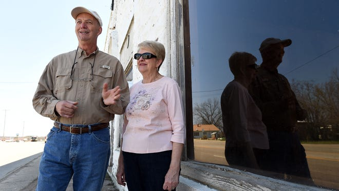 Jack and Sara Gilliland stand in front of the old Rollins Hospital in Gassville on Monday while talking about the renovation project for the building.