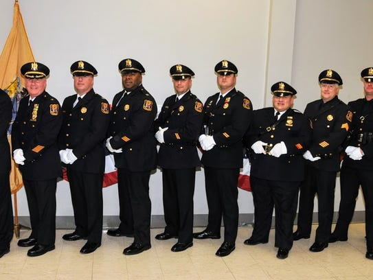 Nine Linden police officers were promoted during a