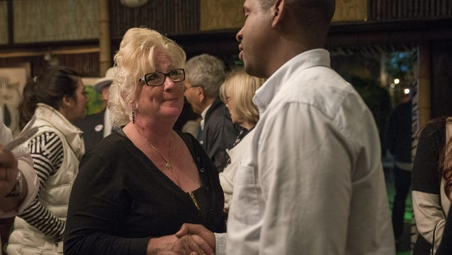 Lake Worth Mayor Pam Triolo shakes hands with Lake Worth City Commissioner Omari Hardy while waiting for the Lake Worth election for mayor results at the Blue Front Bar & Grill in Lake Worth, Fla., on Tuesday, March 13, 2018.