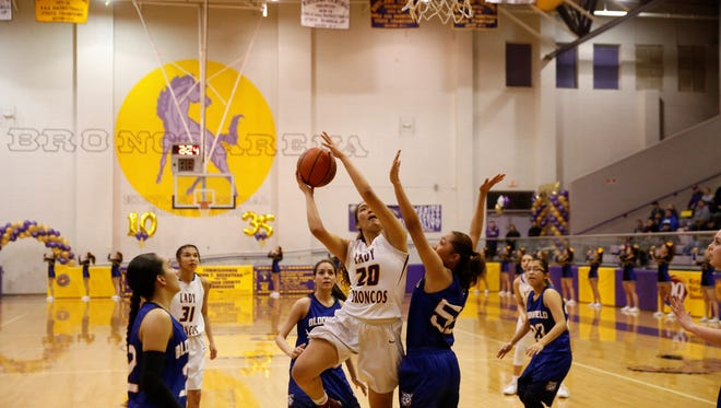 Kirtland Central's Siigrid Lii'bilnaghahi puts up a shot against Bloomfield defender Alyssa Quintana during a district game on Feb. 15 at Bronco Arena. KC hopes to reignite its offense to open the 5A state playoffs.