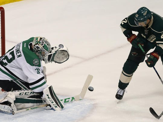 Dallas Stars goalie Kari Lehtonen (32) deflects a shot by Minnesota Wild right wing Nino Niederreiter (22) during the second period on April 18 in St. Paul.