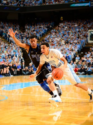 North Carolina Tar Heels guard Marcus Paige (5) dribbles as Duke Blue Devils guard Quinn Cook (2) defends in last year's matchup.
