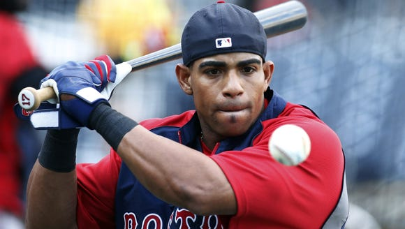 Red Sox left fielder Yoenis Cespedes hits balls to