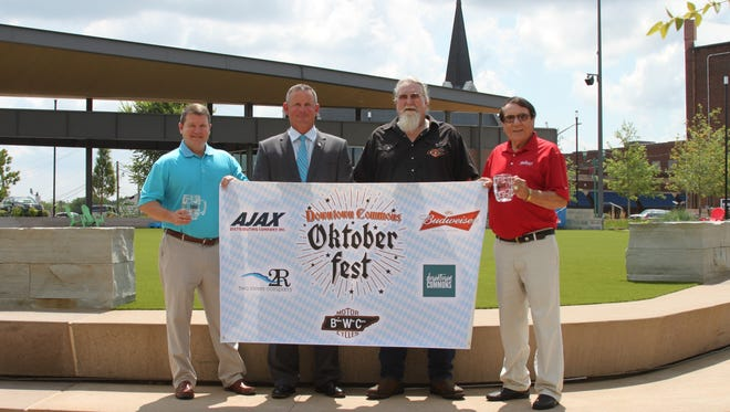 Bikers Who Care is bringing Oktoberfest back to Clarksville, with a Downtown Commons event. From the left are Jeff Turner with Ajax Miller Lite, County Mayor Jim Durrett, BWC President Bill Langford and Charles Hand with Hand Family Companies.
