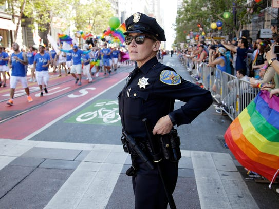 A police officer watches the San Francisco Gay Pride