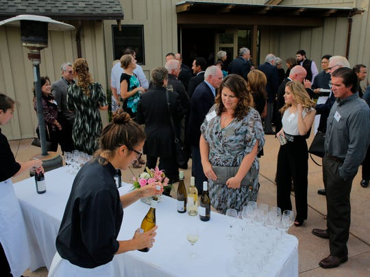Guests indulge in wine and the evening weather Thursday at the Valley of the World Awards.