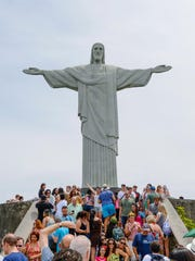 The Christ the Redeemer statue sits atop Corcovado