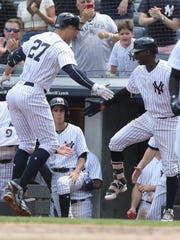 Giancarlo Stanton is greeted at home by Didi Gregorious