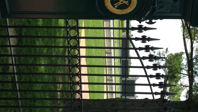 A gate at Keeneland Race Course. The intertwined K and A are taken from the logo of the old Kentucky Association track that was in Lexington before Keeneland.