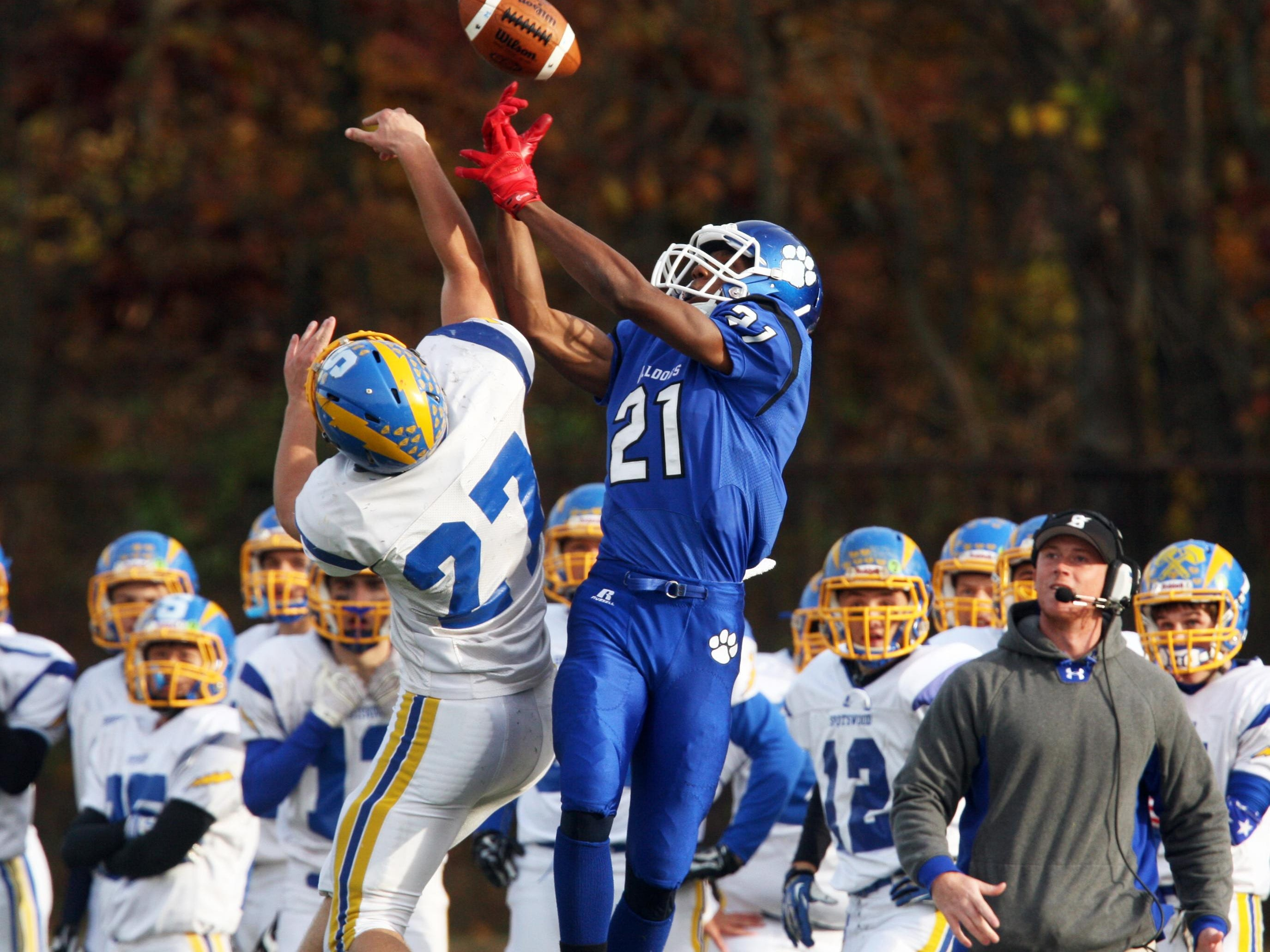 Spotswood at Metuchen varsity football game held at Metuchen High School.Spotswood's # 27 (left)- Ryan Long tries to break up the pass intended for Metuchen's # 21 (right)- Evan Collier.On Saturday November 8, 2014Photo: Mark R. Sullivan/Staff Photographer