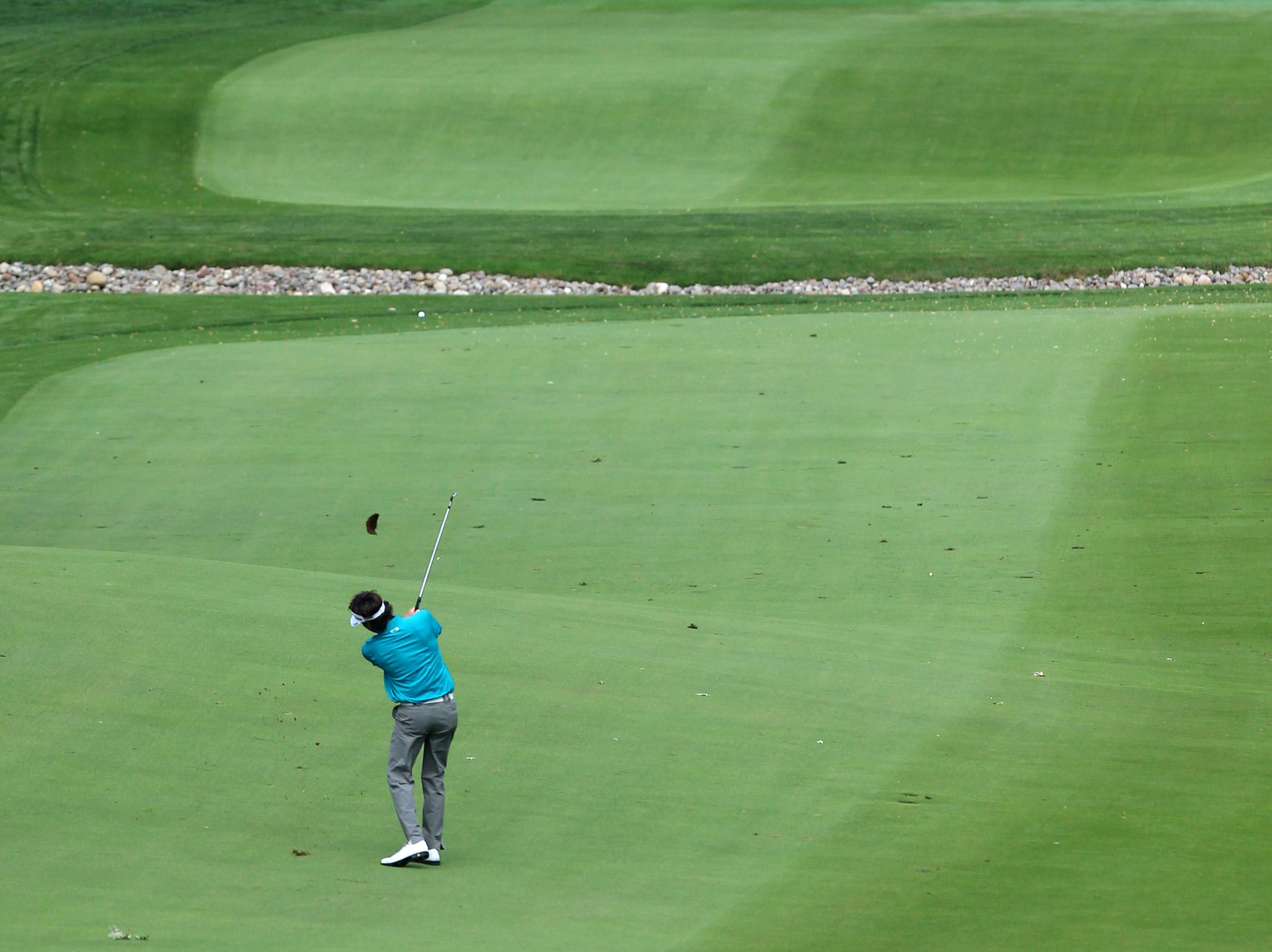 Bubba Watson plays a shot during the practice round of the 95th PGA Championship at Oak Hill Country Club.