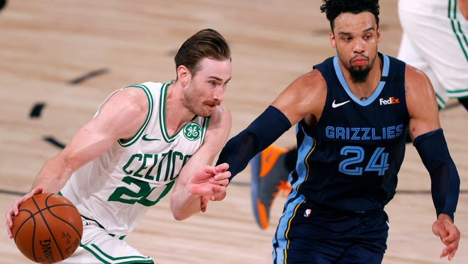 The Celtics' Gordon Hayward, left, drives with the ball as the Grizzlies' Dillon Brooks defends during the second half Tuesday.