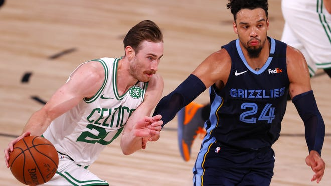 Gordon Hayward of the Boston Celtics drives the ball as Dillon Brooks of the Memphis Grizzlies defends during the fourth quarter at The Arena at ESPN Wide World Of Sports Complex on August 11, 2020 in Lake Buena Vista, Florida.