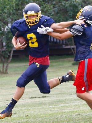 Junior wideout Jackson List avoids a tackle during Tomahawk's practice earlier this month.