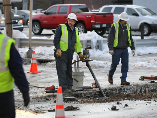 Citizens Energy workers monitor one of two giant holes dug out to try and find a gas main leak that has closed Pennsylvania Street between St. Joseph and Walnut Streets and St. Clair Street between Pennsylvania and Delaware.The streets are expected to remain closed until mid-morning while repairs are made.