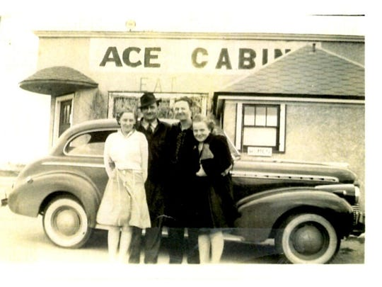 Betty Kowitz, left, Clarence Kowitz and two friends stand in front of the Ace Bar in St. Cloud. The car is a 1940 Chevy, and the photo was taken in the early 1940s.