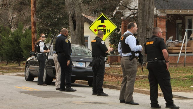 Anderson County Sheriff's Office deputies carried long guns while patrolling a neighborhood after a police chase.