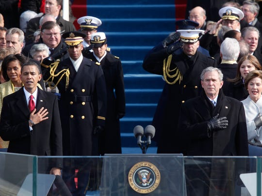 President-elect Barack Obama and President George W. Bush, during Obama's inauguration ceremony in Washington, Jan. 20, 2009. Despite a rash of racist threats and terrorism concerns that ultimately proved unfounded, Obama did not face the kind of large protests expected to greet President-elect Donald Trump when he officially arrives in Washington. (Damon Winter/The New York Times)