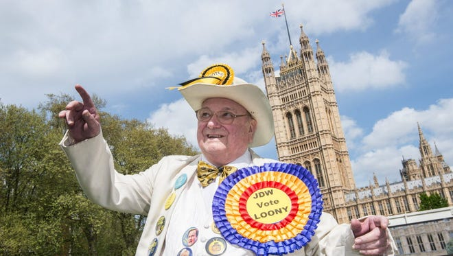 Bringing a touch of lightheartedness to the seriousness of Britain's election campaign, Howling Laud Hope, leader of the Official Monster Raving Loony Party, makes his pitch to the public near the Houses of Parliament in London on May 1.