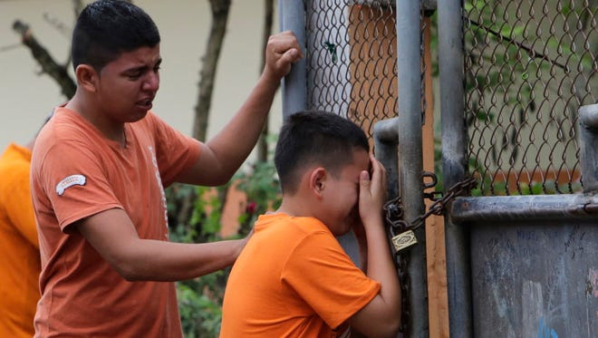 Boys cry as they find out that their sister has been killed in an earthquake in Pedernales, Ecuador, Sunday, April 17, 2016. The strongest earthquake to hit Ecuador in decades flattened buildings and buckled highways along its Pacific coast, sending the Andean nation into a state of emergency.