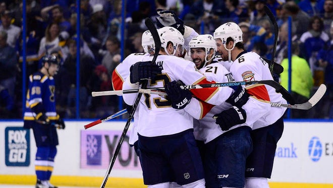 Florida Panthers forward Vincent Trocheck (21) is congratulated by teammates after scoring the game-winning goal in the final seconds against the St. Louis Blues.