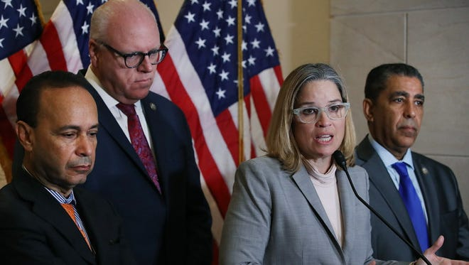 Carmen Yulin Cruz, Mayor of San Juan Puerto Rico, speaks to the media after meeting with the House Democratic Caucus about the current situation in Puerto Rico, on Capitol Hill November 1, 2017 in Washington, DC. Also pictured are (L-R), Rep. Luis Gutierrez, (D-IL), Democratic Caucus Chairman Joseph Crowley (D-NY), Rep. Adriano EspaillatÊ(D-NY).