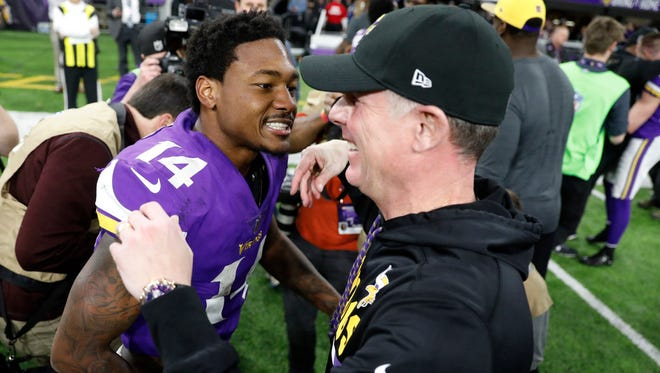 Minnesota Vikings wide receiver Stefon Diggs (14) celebrates with offensive coordinator Pat Shurmur following a 29-24 win over the New Orleans Saints in an NFL divisional football playoff game in Minneapolis, Sunday, Jan. 14, 2018. The Vikings defeated the Saints 29-24.