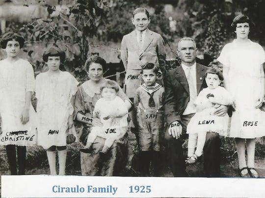Photo from Josie Gaydos of paternal grandfather's Giuseppe Ciraulo's family in 1925. Her grandfather, Giuseppe Ciraulo, is the baby in the middle of the photo.