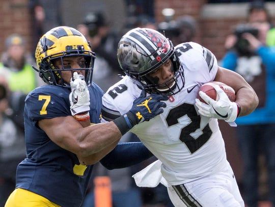 Ohio State freshman tailback J.K. Dobbins tries to
